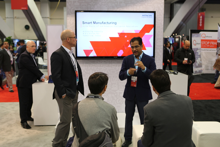 Rajender Yaski, Director Oracle Consulting Services, Hitachi Consulting and Viktor Sahakian, Vice President of Oracle Technology, Hitachi Consulting present Smart Manufacturing for Oracle solution at Hitachi Group booth in Exhibit Hall during Oracle OpenWorld 2018